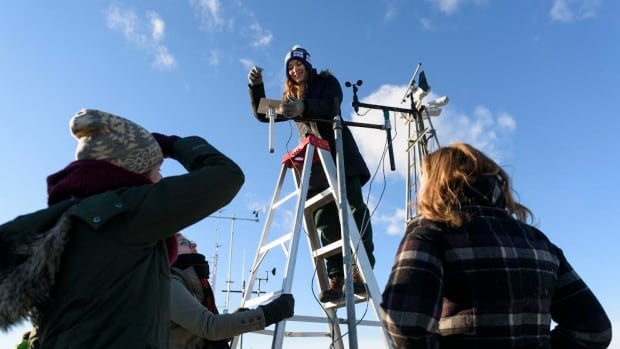 University of Alberta students take measurements on a rooftop weather station, which is a practical part of their environmental instrumentation class.