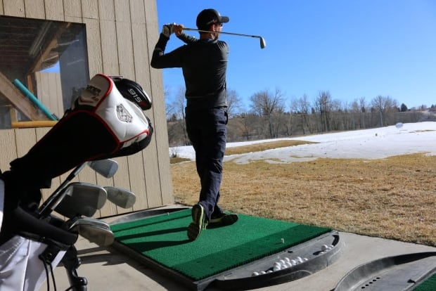 Golfer driving range warm weather