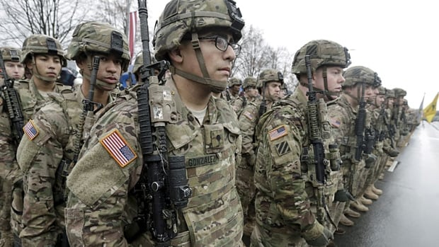 U.S. troops participate in Latvia's Independence Day military parade in Riga in November. There have been a series of moves over the past year, culminating in last week's announcement, to show NATO's flag in Eastern Europe.