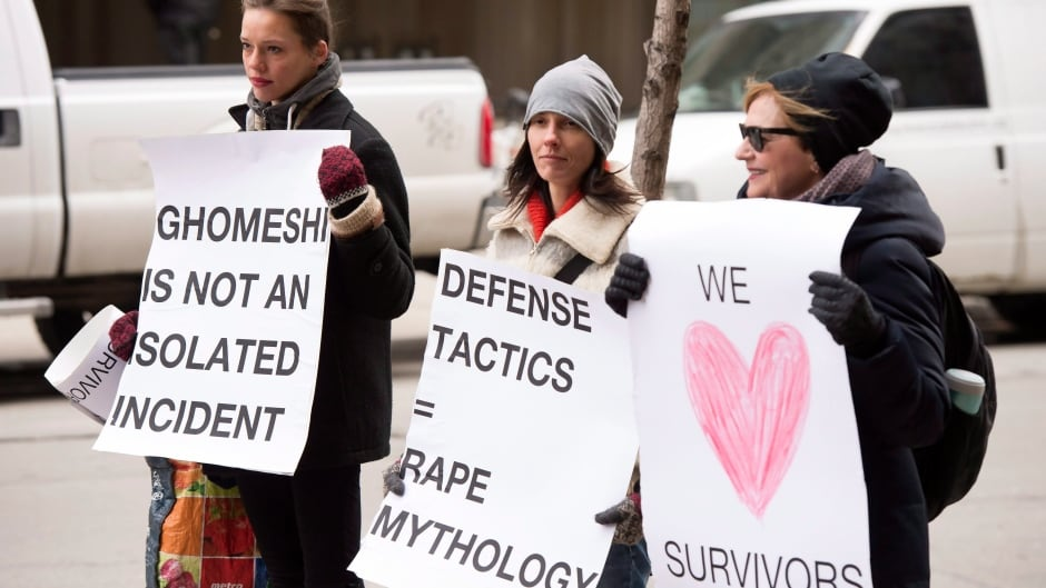 Protesters wait for Jian Ghomeshi to arrive for the third day of his trial on Thursday, Feb. 4, 2016.