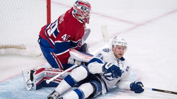 Montreal's Ben Scrivens stopped Tampa Bay's Steven Stamkos on his doorstep and turned away 37 of 39 shots to help the Canadiens to a third consecutive victory, 4-2.