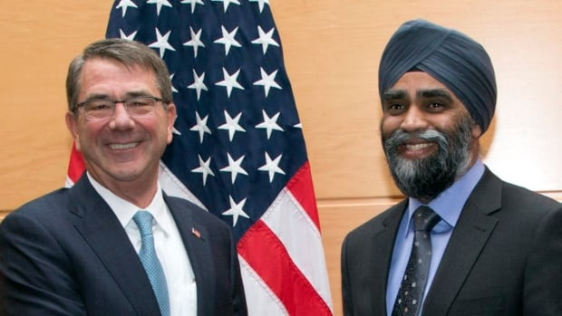 U.S. Secretary of Defence Ash Carter, left, shakes hands with Defence Minister Harjit Sajjan prior to a bilateral meeting at NATO headquarters in Brussels on Wednesday, Feb. 10, 2016.