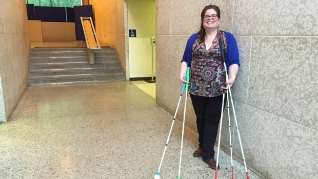 Lisa Tefler with CNIB stands with white canes.