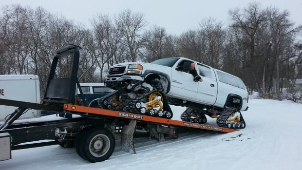 Robert Stutsky unloading the track truck at Lake Winnipeg.