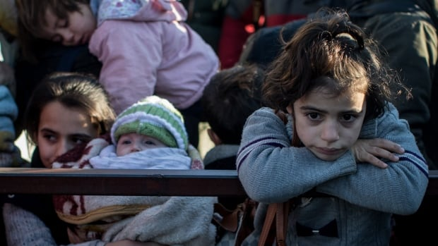 A young girl is seen waiting in line to pass through a border gate as a small number of Syrian refugees were allowed to return to Syria at the closed Turkish border gate on February 8, 2016 in Kilis, Turkey. U.S., Russia and other countries will discuss different options for ending the Syrian civil war in Munich this week.