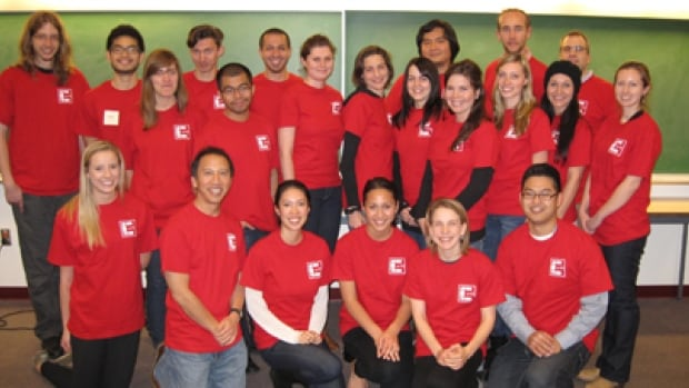 Tim Tanaka (first row, second from left) poses with the Center for Autism Research Technology and Education team that developed the app.