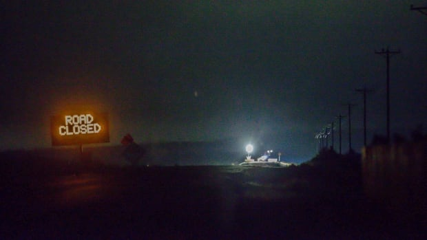 Lights are seen from the Narrows roadblock near Burns, Ore., as FBI agents on Wednesday nights surrounded the remaining four occupiers at the Malheur National Wildlife Refuge.