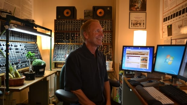 Music producer Roger Dumas in his office at the Brain Science Center in Minneapolis.