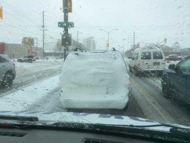 Photo of snow-covered van on London's Wonderland Road