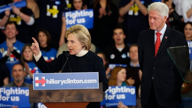 Hillary Clinton is accompanied by her husband, former U.S. President Bill Clinton, as she speaks at her final 2016 New Hampshire presidential primary night rally in Hooksett, NH. She has battled perceptions of dishonesty, and critics say Clinton has misread the mood for progressive change so far in the campaign.