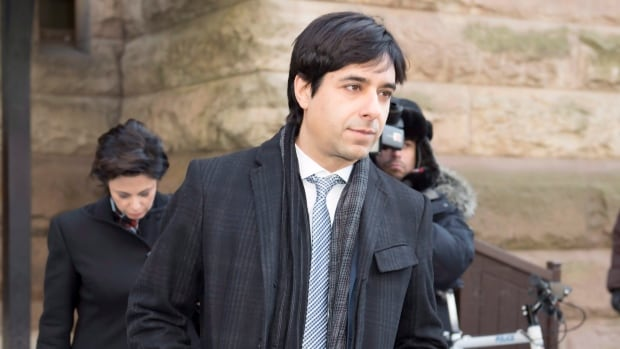 Jian Ghomeshi and his lawyer Marie Henein leave court in Toronto following closing arguments in his sexual assault trial on Thursday.