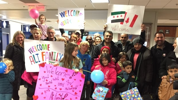 The Ali family and a welcoming party at Halifax Stanfield Airport. This week the federal government will likely hit the target of 25,000 refugees, but because one third of those are privately sponsored, another 8,000 government-sponsored refugees will be coming to Canada from Syria by year's end.