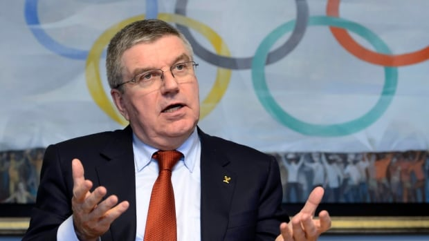 "IOC president Thomas Bach, shown in this December 2015 file photo, says he has ""full confidence"" in the actions being undertaken by the Brazilian authorities and global health organizations to combat the outbreak of the mosquito-borne Zika virus."