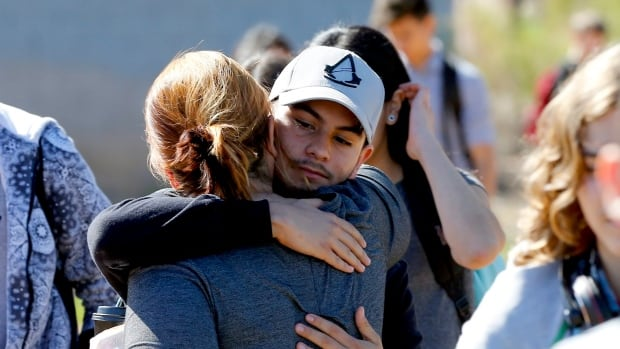 Parents and students reunite Friday after two teens were shot at Independence High School in the Phoenix suburb of Glendale.