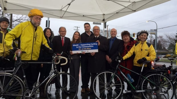 B.C. Transportation Minister Todd Stone, middle, is encouraging communities to apply for provincial funding to build cycling or walking infrastructure.