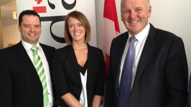 Orenda Software Solutions founder and CEO Tanya Collier-MacDonald, flanked by MLA Derek Mombourquette (left) and MP Mark Eyking.