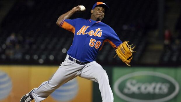 In this April 3, 2015 photo, New York Mets relief pitcher Jenrry Mejia delivers to the Texas Rangers in the eighth inning of a exhibition baseball game in Arlington, Texas. The Dominican pitcher became the first player to be handed a lifetime ban Friday by the MLB.