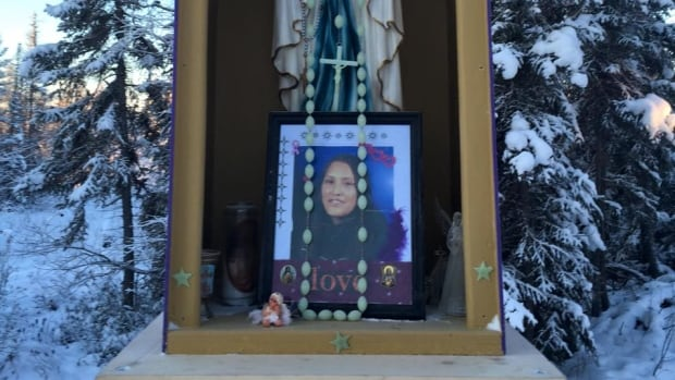 A memorial for Charlotte Lafferty stands in Fort Good Hope, N.W.T. Lafferty was murdered near the community's elders' complex on March 22, 2014.