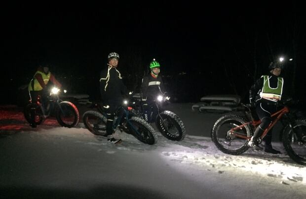 Winter bicyclists at night in Corner Brook