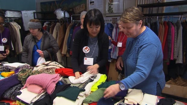 Tables with donated winter clothes were set up as the city gears up for a frigid weekend.