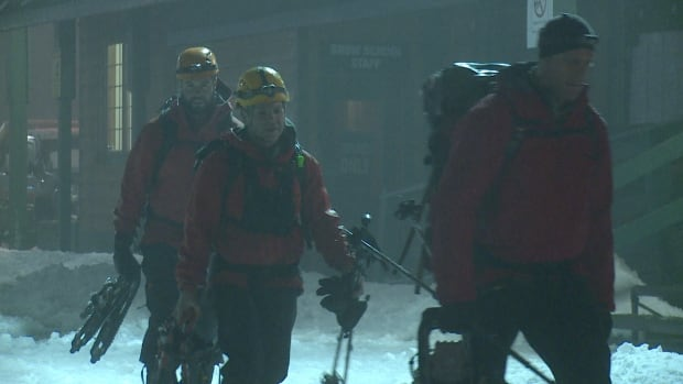 NSR team members return to base after suspending a search for a missing hiker and his dog until Sunday morning.