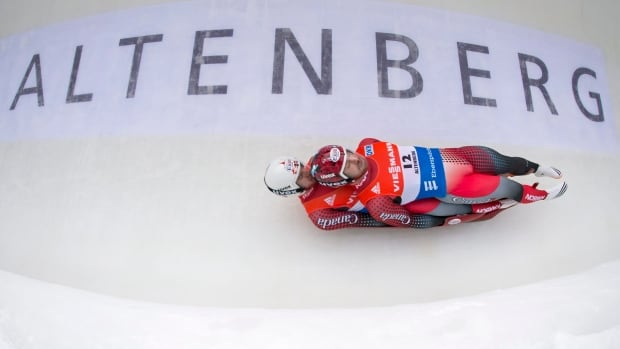 Tristan Walker from Calgary, front, and Justin Snith from Cochrane, compete during the doubles luge World Cup race in Altenberg, Germany, on Feb. 13. The two earned silver for Canada as part of the team luge race.