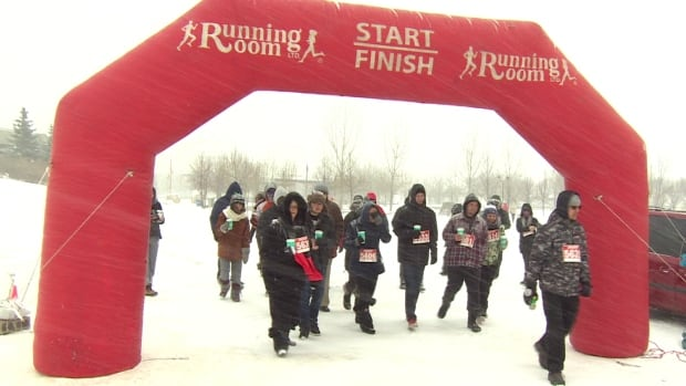 Dozens of participants walked five kilometres in the blowing snow Sunday to help raise funds for prostate cancer research.