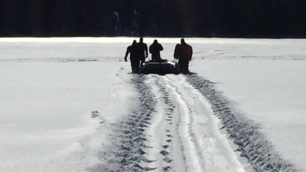 RCMP divers entered the water Monday to search for a man who fell through the ice on a snowmobile.