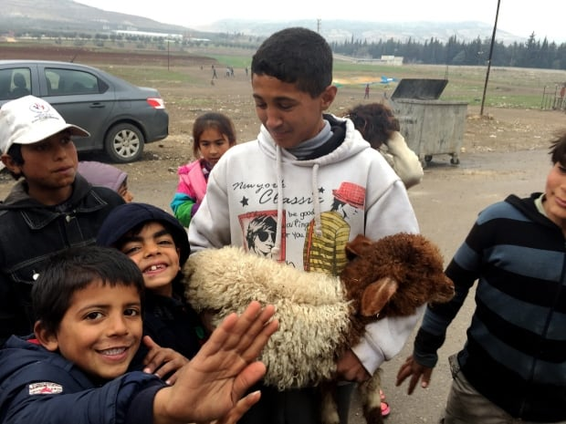 Syrian children living in Kilis Turkey gather with one of the go
