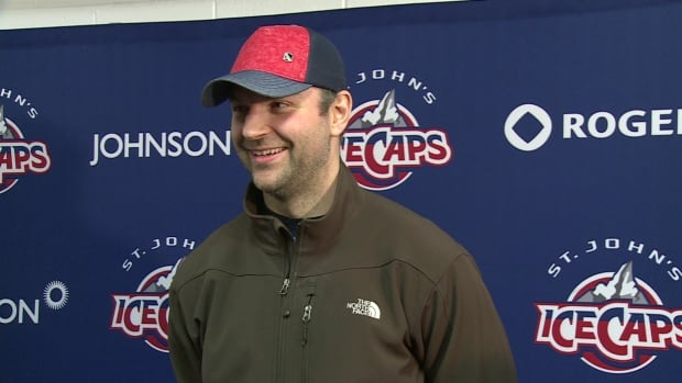 John Scott speaks to reporters after a practice at Mile One Saturday.