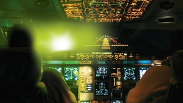 A laser shone into a cockpit can temporarily blind a pilot.