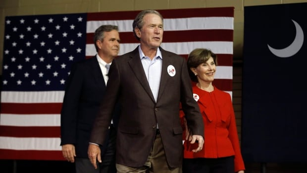 Republican presidential candidate and former Florida Gov. Jeb Bush, left, accompanied by his brother former President George W. Bush, centre, and George's wife Laura Bush take the stage during a campaign stop Monday in North Charleston, S.C. (