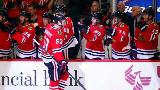 Chicago Blackhawks left wing Brandon Mashinter (53) celebrates his goal against the Toronto Maples with teammates during the first period of Monday night's 7-2 victory.