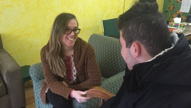 Hannah Deloughery of Romero House, a shelter for refugees, meets with Mohammed, a teenage boy from Syria who had faced deportation to the United States.