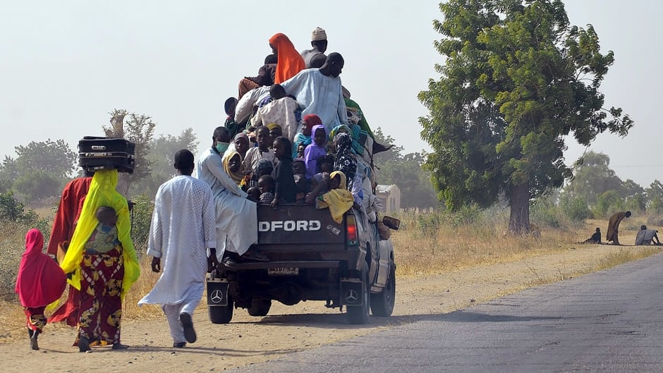 A loaded truck wait to carry people fleeing from Boko Haram Islamists at Mairi village outskirts of Maiduguri capital of northeast Borno State, on Feb. 6, 2016.