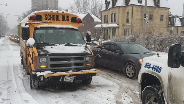 A car crashed into a school bus near the intersection of Sherboune and Gerrard Streets on Tuesday morning.