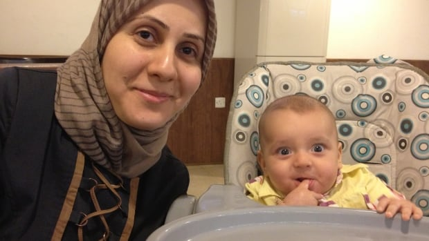 Farrah Ali seen here with her son before a bomb blast left her with severe injuries to her face and arm.