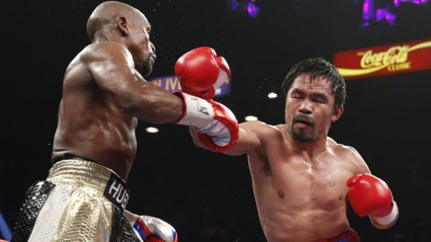 Manny Pacquiao, right, is facing backlash about his comments about same-sex marriage.