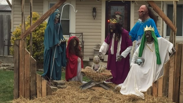 Jasen Dixon was cited for zoning violations for the 'zombie nativity' display on his front lawn in the Ohio township of Sycamore.