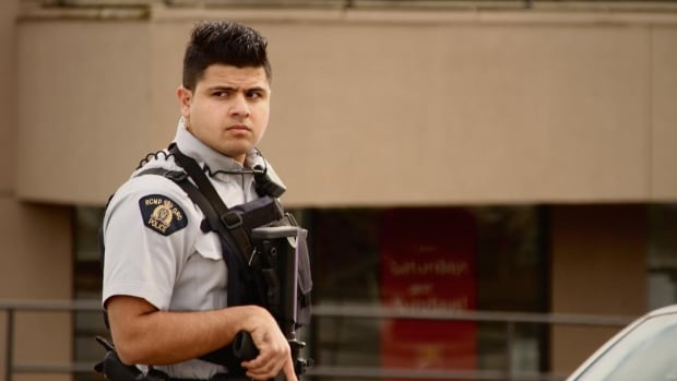 RCMP surrounded a bank in Surrey for several hours Tuesday following a standoff with a man inside.
