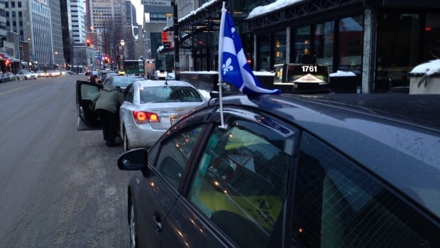 Taxis queue during Wednesday morning's protest in downtown Montreal.