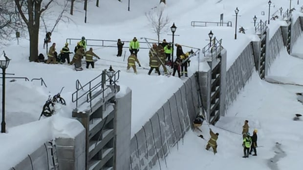 Emergency crews rescue a woman from the Rideau Canal near the Chateau Laurier Wed., Feb. 17, 2016.