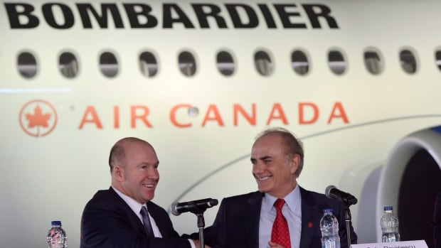 Bombardier CEO Alain Bellemare, left, shook hands with Air Canada's CEO Calin Rovinescu in February when the agreement in principle for the jets was reached.