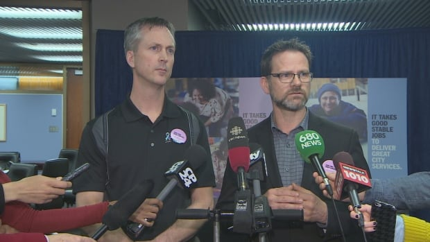 CUPE Local 416 bargaining committee member Matt Alloway, left, and CUPE Local 79 president Tim Maguire, right, announce both their locals submitted new proposals to city officials Wednesday morning.