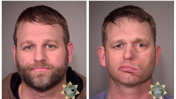 Ammon Bundy, left, and his brother Ryan Bundy are seen in a combination of police jail booking photos released by the Multnomah County Sheriff's Office in Portland, Ore. on Jan. 27.