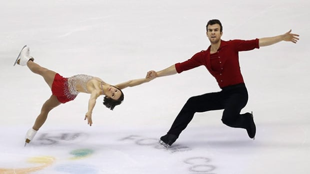 Meagan Duhamel and Eric Radford of Canada perform during the pairs short program of the Four Continents figure skating championships in Taipei on Thursday. Duhamel and Radford finished in second place.