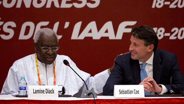 Sebastian Coe, right, seen in this file photo, said Thursday Kenya could face similar sanctions as those brought against Russia and risk being barred from the upcoming Rio Olympics if it fails to comply with anti-doping rules.
