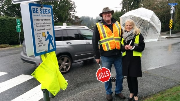 Parent Tarron Falk (left) and School Principal Judy Duncan hope the brightly coloured flags act as a deterrent for drivers who would may otherwise blow past stop signs.
