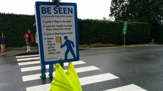 Anyone who cross at the intersection of Mathers Avenue and Thompson Crescent in West Vancouver can use these flags to remind drivers to slow down.