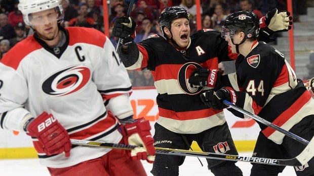 The Hurricanes' Eric Staal, left, skates away as the Senators' Chris Neil and Jean-Gabriel Pageau (44) celebrate a goal by teammate Zack Smith, not shown, earlier this month.